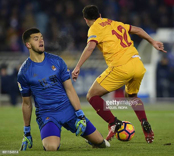 Sevilla's French forward Wissam Ben Yedder controls the ball next to Real Sociedad's Argentinian goalkeeper Geronimo Rulli prio to scoring his second...