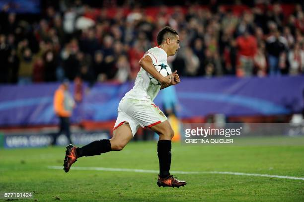 Sevilla's French forward Wissam Ben Yedder grabs the ball after scoring a goal on November 21 2017 at the Ramon Sanchez Pizjuan stadium in Sevilla...