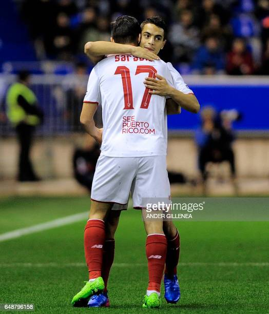 Sevilla's French forward Wissam Ben Yedder is congratulated by teammate midfielder Pablo Sarabia after scoring his team's first goal during the...