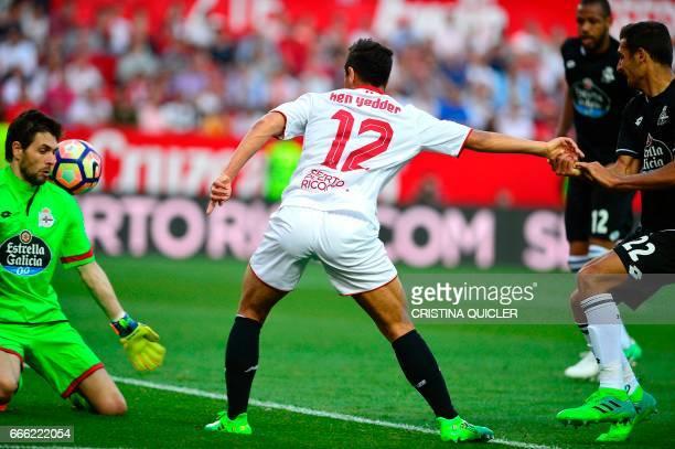 Sevilla's French forward Wissam Ben Yedder scores a goal during the Spanish league football match Sevilla FC vs RC Deportivo de la Coruna at the...