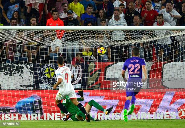 Sevilla's French forward Wissam Ben Yedder shoots the ball to score a goal during the Spanish league footbal match Sevilla FC vs Club Deportivo...