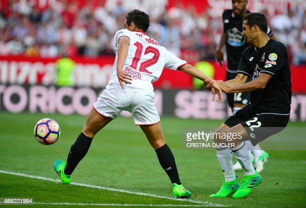 Sevilla's French forward Wissam Ben Yedder shoots to score a goal during the Spanish league football match Sevilla FC vs RC Deportivo de la Coruna at...