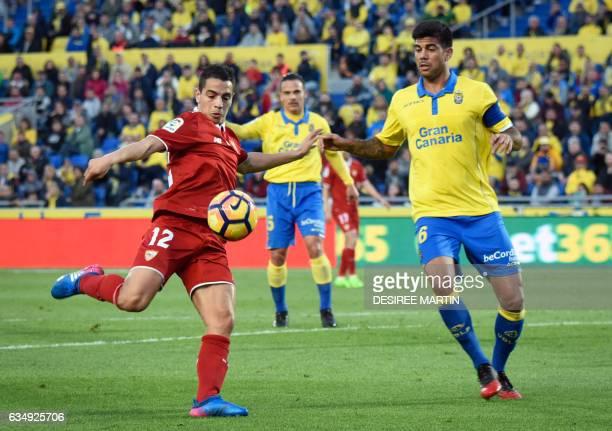 Sevilla's French forward Wissam Ben Yedder vies with Las Palmas' defender Aythami Artiles during the Spanish league football match UD Las Palmas vs...