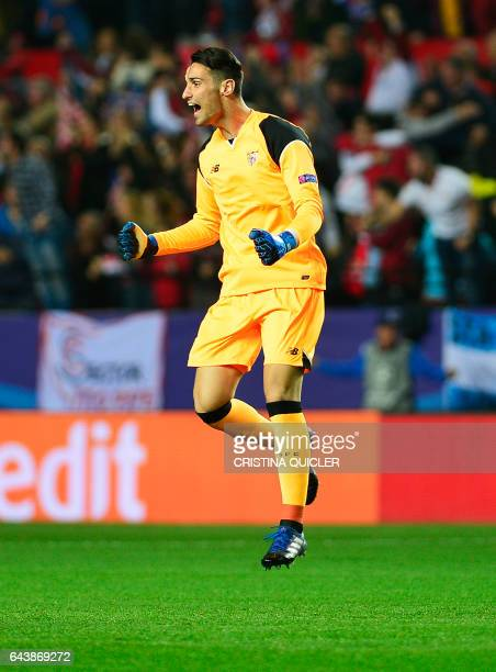 Sevilla's goalkeeper Sergio Rico Gonzalez celebrates after a goal during the UEFA Champions League round of 16 second leg football match Sevilla FC...