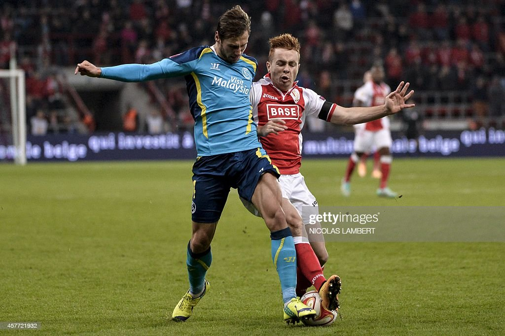 Sevilla's Grzegorz Krychowiak and Standard's Adrien Trebel vie for the ball during a third group stage game between Belgian first division soccer...