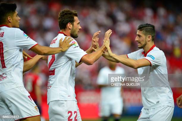 Sevilla's Italian forward Franco Vazquez celebrates after scoring a goal with Sevilla's Argentinian midfielder Joaquin Correa and Sevilla's...