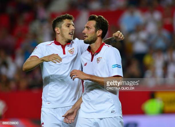 Sevilla's Italian forward Franco Vazquez celebrates after scoring a goal with Sevilla's Montenegrin forward Stevan Jovetic during the Spanish league...