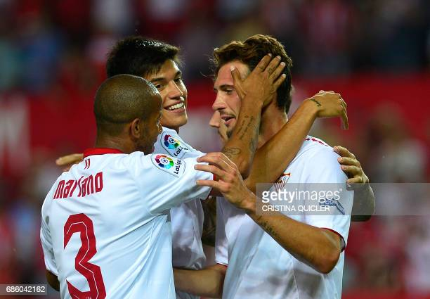 Sevilla's Italian forward Franco Vazquez celebrates after scoring a goal with Sevilla's Brazilian defender Mariano and Sevilla's Argentinian...