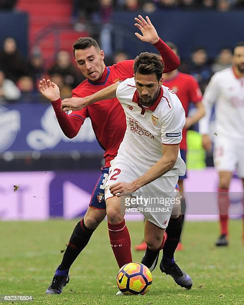 Sevilla's Italian midfielder Franco Damian Vazquez vies with Osasuna's midfielder Imanol Garcia during the Spanish league football match CA Osasuna...