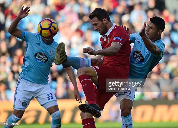 Sevilla's Italian midfielder Franco Vazquez vies with Celta Vigo's Argentinian defender Facundo Roncaglia during the Spanish league football match RC...