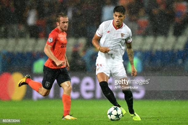 Sevilla's Joaquin Correa vies for the ball with Basaksehir's Edin Visca during the UEFA Champions League playoff first leg football match between...