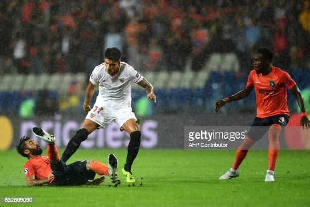 Sevilla's Joaquin Correa vies for the ball with Basaksehir's Mahmut Tekdemir and Joseph Attamah during the UEFA Champions League playoff first leg...