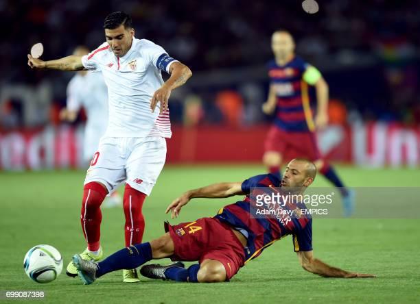 Sevilla's Jose Antonio Reyes and Barcelona's Javier Mascherano battle for the ball