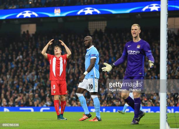 Sevilla's Kevin Gameiro shows his frustration after missing a chance against Manchester City