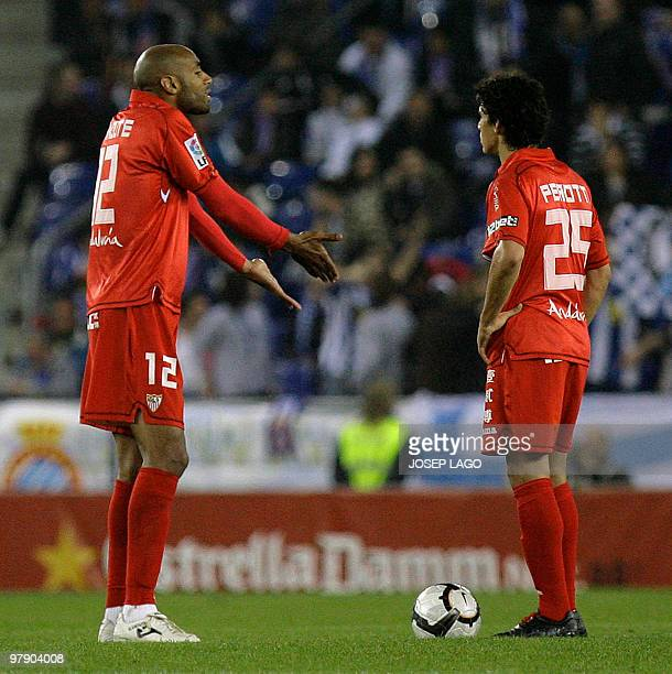 Sevilla's Malian forward Frederic Kanoute speaks with teammate Argentinian midfielder Diego Perotti during their Spanish League football match...