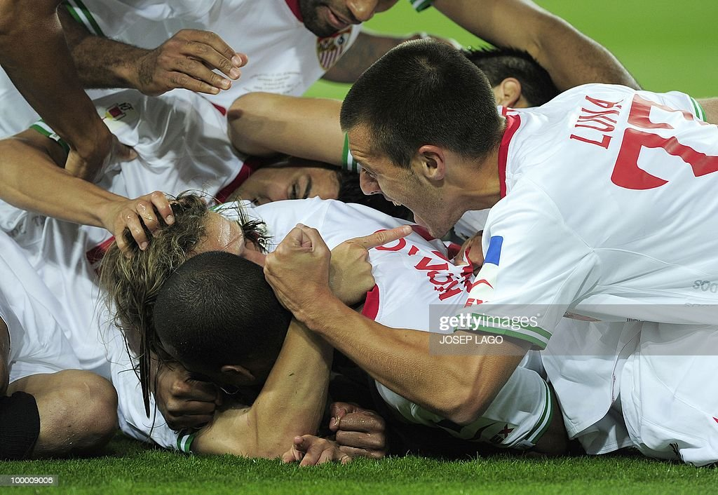 Sevilla's midfielder Diego Capel (C) is congratuled by his teammates after scoring during the King's Cup final match Sevilla against Atletico Madrid at the Camp Nou stadium in Barcelona on May 19, 2010.