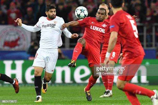 Sevilla's midfielder from Argentina Ever Banega and Spartak Moscow's midfielder from Brazil Fernando vie for the ball during the UEFA Champions...