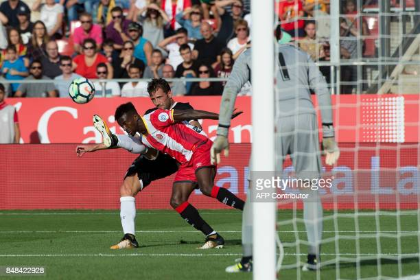 Sevilla's midfielder from Italy Franco Vazquez vies with Girona's Nigerian forward Larry Kayode during the Spanish league football match Girona FC vs...