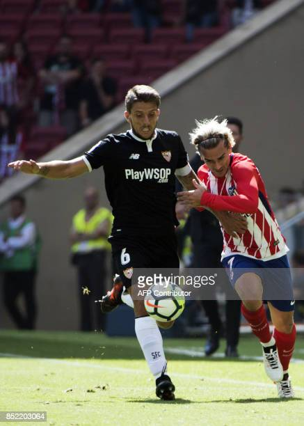 Sevilla's midfielder from Portugal Daniel Carrico vies with Atletico Madrid's forward from France Antoine Griezmann during the Spanish league...