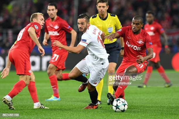 Sevilla's midfielder from Spain Pablo Sarabia and Spartak Moscow's midfielder from Brazil Fernando vie for the ball during the UEFA Champions League...