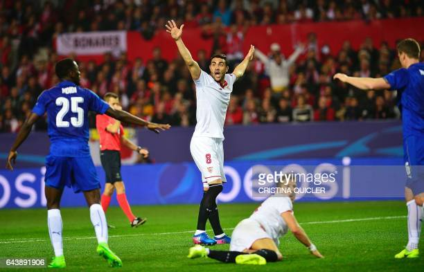 Sevilla's midfielder Iborra gestures with Sevilla's Montenegrin forward Stevan Jovetic during the UEFA Champions League round of 16 second leg...