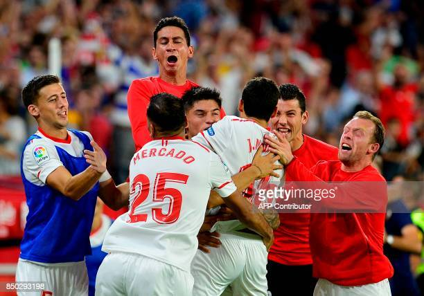 Sevilla's midfielder Jesus Navas celebrates a goal with teammates during the Spanish league football match Sevilla FC against UD Las Palmas at the...