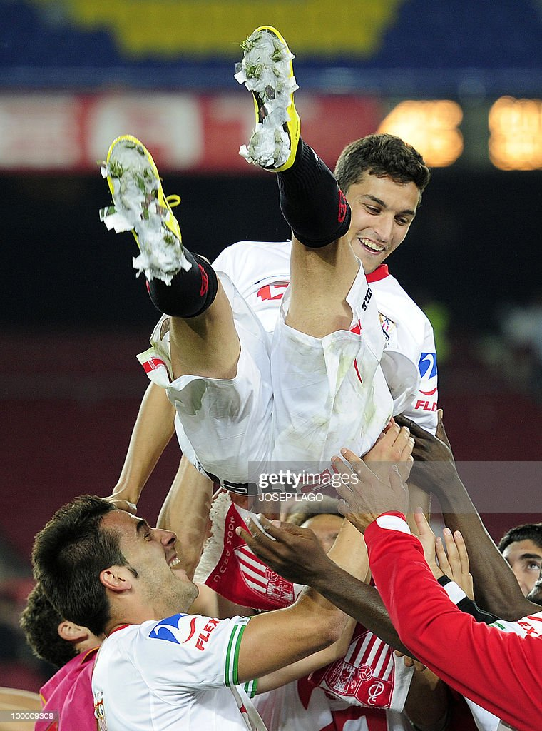 Sevilla's midfielder Jesus Navas celebrates with teammates after winning the King's Cup final match against Atletico Madrid at the Camp Nou stadium in Barcelona on May 19, 2010. Sevilla won 2-0.