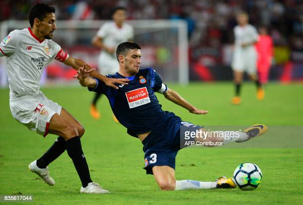 Sevilla's midfielder Jesus Navas vies with Espanyol's defender Aron Martin during the Spanish league football match Sevilla FC vs Espanyol at the...