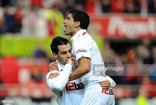 Sevilla's midfielder Álvaro Negredo celebrates after scoring with Sevilla's Brazilian midfielder Renato against Almeria during a Spanish league...