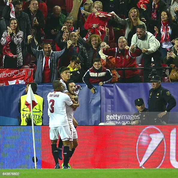 Sevilla's midfielder Pablo Sarabia celebrates after scoring a goal during the UEFA Champions League round of 16 second leg football match Sevilla FC...