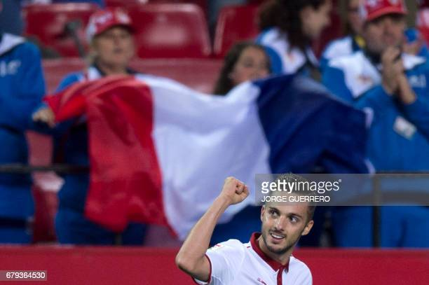 Sevilla's midfielder Pablo Sarabia celebrates after scoring during the Spanish league football match Sevilla FC vs Real Sociedad at the Ramon Sanchez...