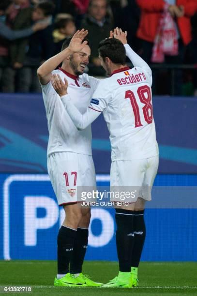 Sevilla's midfielder Pablo Sarabia celebrates after scoring with Sevilla's defender Sergio Escudero during the UEFA Champions League round of 16...