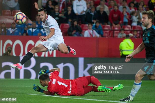 Sevilla's midfielder Pablo Sarabia scores past Real Sociedad's Argentinian goalkeeper Geronimo Rulli during the Spanish league football match Sevilla...