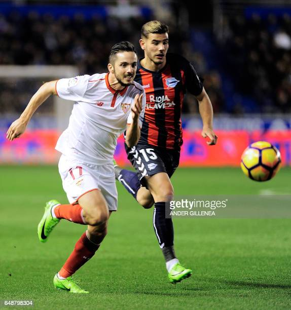 Sevilla's midfielder Pablo Sarabia vies with Deportivo Alaves' French defender Theo Hernandez during the Spanish league football match Deportivo...