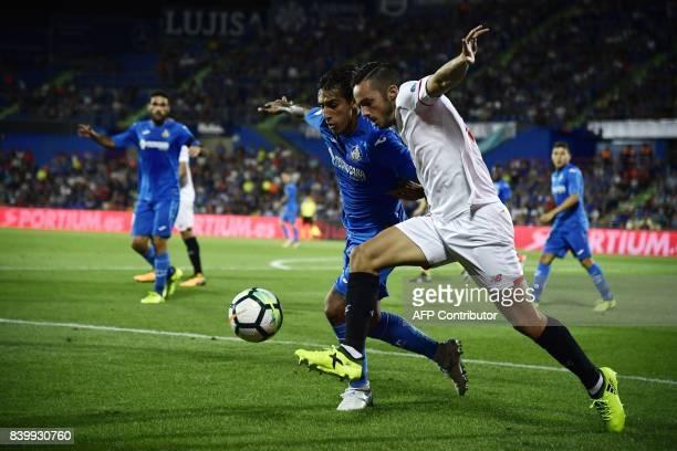 Sevilla's midfielder Pablo Sarabia vies with Getafe's Uruguayan defender Damian Suarez during the Spanish league football match Getafe CF vs Sevilla...