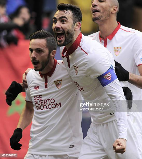 Sevilla's midfielder Vicente Iborra and midfielder Pablo Sarabia celebrate after their team's third goal during the Spanish league football match CA...