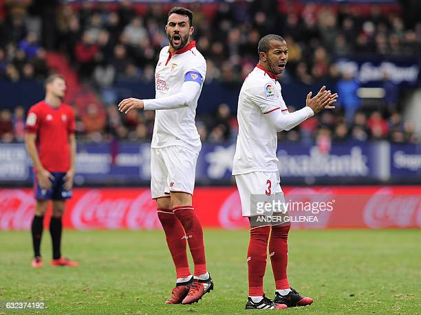 Sevilla's midfielder Vicente Iborra and teammate Brazilian defender Mariano Ferreira Filho celebrate after scoring his team's second goal during the...
