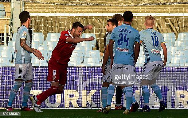 Sevilla's midfielder Vicente Iborra celebrates after scoring a goal during the Spanish league football match RC Celta de Vigo vs Sevilla FC at the...