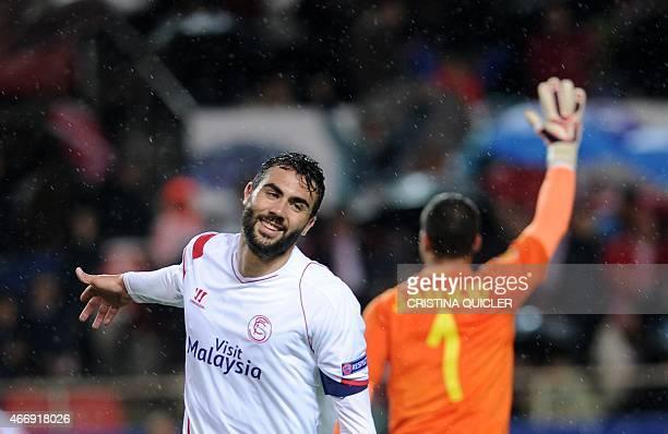 Sevilla's midfielder Vicente Iborra celebrates after scoring during the Europa League football match FC Sevilla vs Villarreal CF at the Ramon Sanchez...