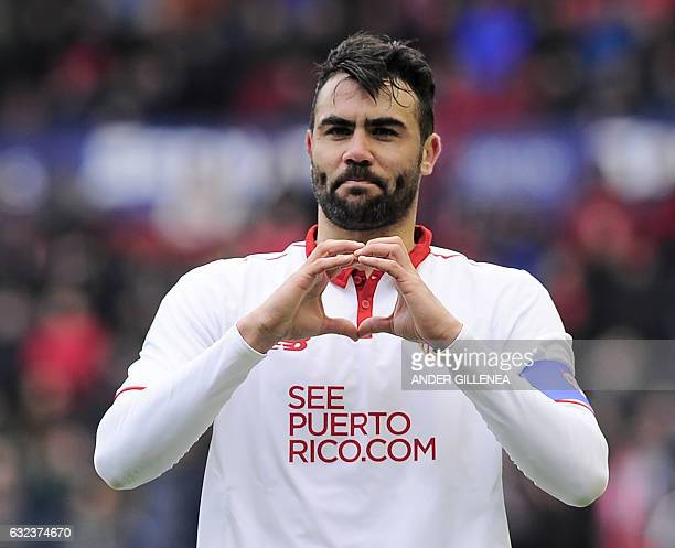 Sevilla's midfielder Vicente Iborra celebrates after scoring his team's first goal during the Spanish league football match CA Osasuna vs Sevilla FC...