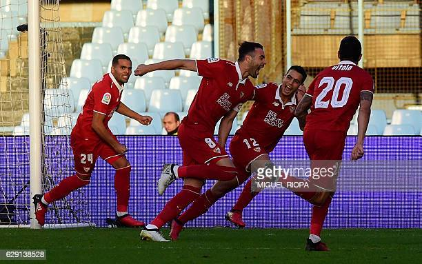 Sevilla's midfielder Vicente Iborra celebrates with teammates after scoring during the Spanish league football match RC Celta de Vigo vs Sevilla FC...