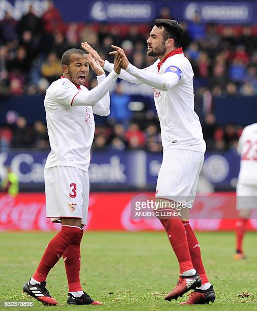 Sevilla's midfielder Vicente Iborra is congratulated by teammate Brazilian defender Mariano Ferreira Filho after scoring his team's second goal...