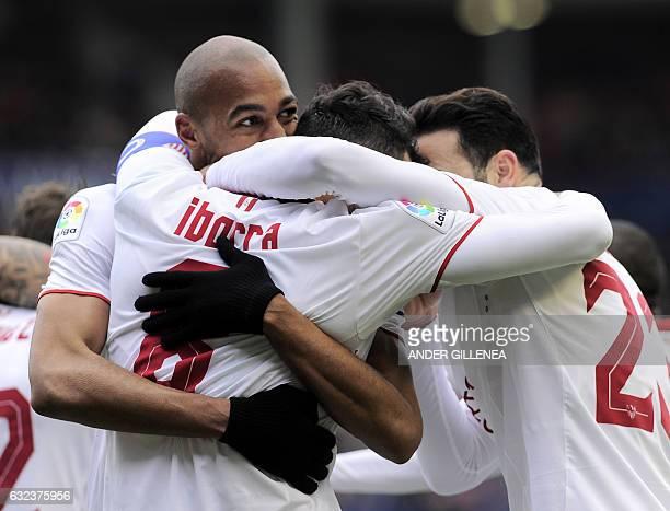 Sevilla's midfielder Vicente Iborra is congratulated by teammates Brazilian defender Mariano Ferreira Filho French defender Adil Rami after scoring...