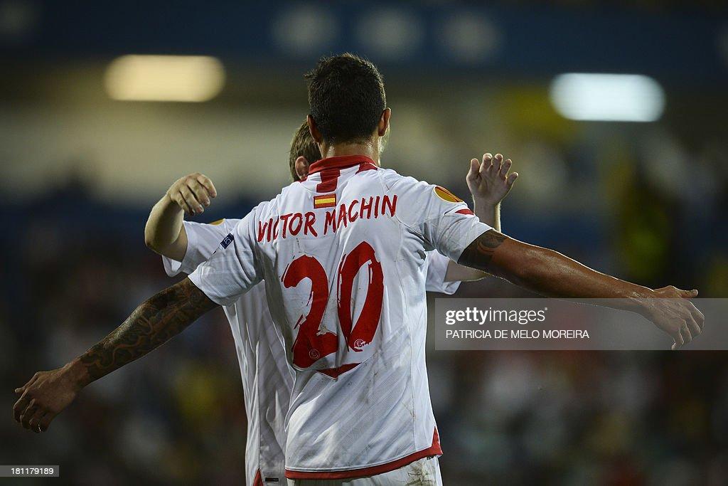 Sevilla's midfielder Victor Machin celebrates with a teammate after scoring during the UEFA Europa League, group H, football match Estoril vs Sevilla at the Antonio Coimbra da Mota stadium in Estoril on September 19, 2013.