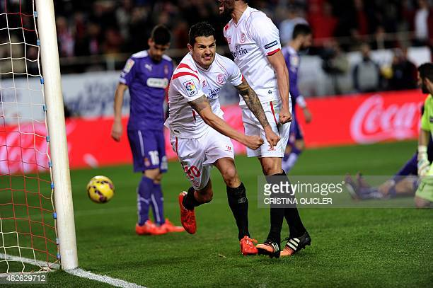 Sevilla's midfielder Vitolo celebrates after scoring against Espanyol during the Spanish league football match Sevilla FC vs RCD Espanyol at the...