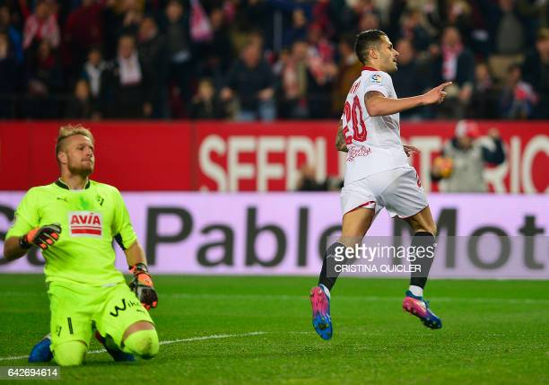 Sevilla's midfielder Vitolo celebrates after scoring during the Spanish league football match Sevilla FC vs SD Eibar on February 18 2017 Sevilla won...