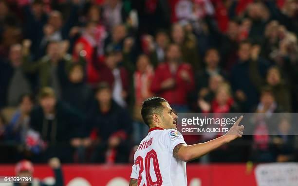 Sevilla's midfielder Vitolo celebrates after scoring during the Spanish league football match Sevilla FC vs SD Eibar on February 18 2017 Sevilla won...