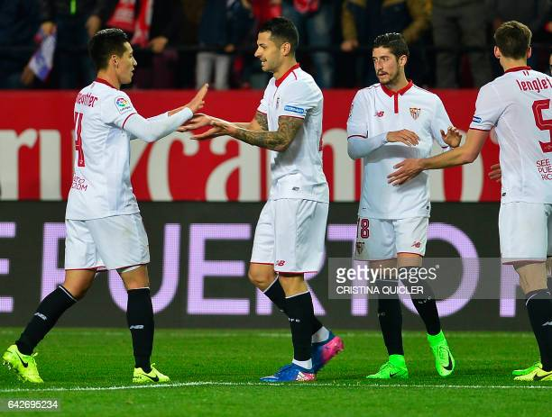 Sevilla's midfielder Vitolo celebrates with teammates after scoring during the Spanish league football match Sevilla FC vs SD Eibar on February 18...