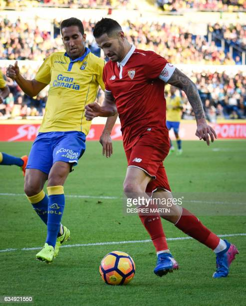 Sevilla's midfielder Vitolo vies with Las Palmas' midfielder Angel Montoro during the Spanish league football match UD Las Palmas vs Sevilla FC at...