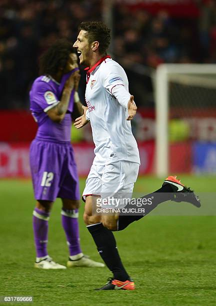 Sevilla's Montenegrin forward Stevan Jovetic celebrates after scoring the 21 victory goal during the Spanish league football match Sevilla FC vs Real...
